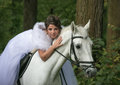 Walk with the favourite young beautiful woman on a white horse Stock Photos
