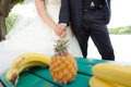 Walk with fruits bride and groom in park Stock Photography