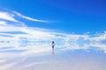 A walk into the horizon female walks at salar de uyuni salt flats in bolivia Royalty Free Stock Photo
