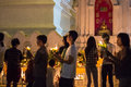 Walk with lighted candles in hand around a temple people Royalty Free Stock Photos
