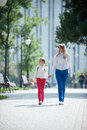 Walk in the park mother and daughter walking summer Royalty Free Stock Images