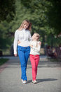 Walk in the park mother and daughter walking summer Royalty Free Stock Photography