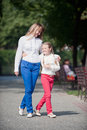 Walk in the park mother and daughter walking summer Stock Photo