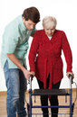 Walker lesson nurse teaching elder disabled person how to walk with Stock Photography