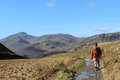 Walker on mountain footpath in Lake District Royalty Free Stock Photo