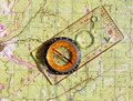 Walkers compass and on a topo map liquid filled Stock Image