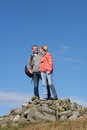 Walkers Standing On Pile Of Rocks Royalty Free Stock Photo