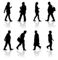 Walking adults silhouettes silhouette illustration of a group of in various poses Stock Images