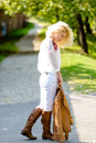 Walking alone a beautiful woman with curly long hair is feeling sad slowly Stock Image