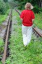 Walking Away Along Abandoned Railroad Track Stock Photos