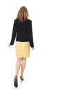 Walking away young business woman is Royalty Free Stock Image