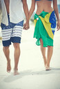 Walking on beach couple in love with brasil flag sarong Stock Image