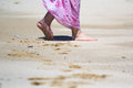 Walking on a beach woman wearing sarong sandy Royalty Free Stock Photography