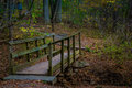 Walking bridge on park hiking trail Royalty Free Stock Photo