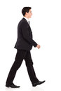 Walking businessman in black suit smiling young full length studio shot isolated on white Stock Photos