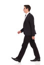 Walking businessman in black suit young elegance man full length studio shot isolated on white Stock Photos