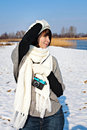 Walking with a camera in winter young female photographer Stock Image