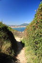 Walking on coastal pathway taking photos of scenic atlantic coast in summer blue sky, hendaye, basque country, france Royalty Free Stock Photo