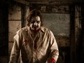 Walking dead photo of a hungry zombie covered with blood about to attack you Stock Image