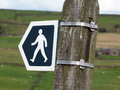Walking direction sign indicating a path or public footpath Royalty Free Stock Photo