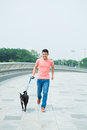 Walking with a dog image of young man his outside Stock Images