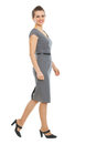 Walking elegant business woman in dress Stock Image