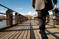 Walking on a jetty man walk wood extended the river thames in london Stock Image