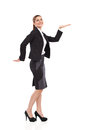 Walking like an egyptian side view of smiling and businesswoman in black suit mini skirt and high heels full length studio shot Stock Images