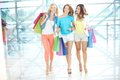Walking in the mall gorgeous girlfriends with paperbags down trade center Royalty Free Stock Photography