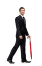 Walking man with closed umbrella red isolated on white Royalty Free Stock Photography
