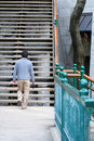 Walking man go to stairs 2 Stock Photos
