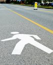 Walking man road sign at office building silhouette of a person in motion painted on the street outside an a marking a pedestrian Stock Image