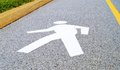 Walking man silhouette of a person in motion painted on the street a road sign marking a pedestrian trail Royalty Free Stock Photography