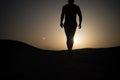 Walking man silhouette at sunset sky Royalty Free Stock Photo