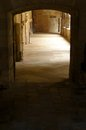 Walking into monastery entrance door way to quiet a concept photograph showing a long empty passage in an ancient medieval in Stock Photos