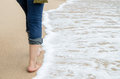 Walking nearly beach sand and sea Stock Image