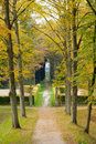 Walking in the park with the brilliant colors of autumn a path and fence a along a castle netherlands at Stock Photos