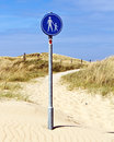 Walking path sign traffic for a sandy through the dunes at the north sea coast of the netherlands Royalty Free Stock Photography