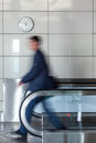 Walking person on walkway young businessman in the airport Stock Photography