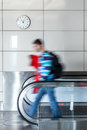 Walking person on walkway young man in the airport Royalty Free Stock Photography