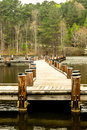 Walking pier over calm waters a maze of a early morning on a cloudy rainy day Stock Photography