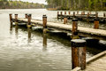 Walking pier over calm waters a maze of a early morning on a cloudy rainy day Royalty Free Stock Photo