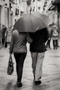 Walking in the rain a couple a street granada spain Royalty Free Stock Photos