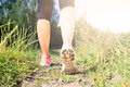 Walking or running legs in forest adventure and exercising exercise on green grass footpath achievement fitness spring Royalty Free Stock Image