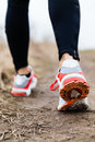 Walking or running legs sport shoes fitness and exercising in autumn winter nature Stock Photos