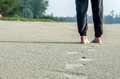 Walking on the sand feet and footprints a sandy beach Royalty Free Stock Photography