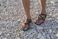 Walking in sandals on beach Royalty Free Stock Photo