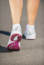 Walking in sports shoes. Royalty Free Stock Photo