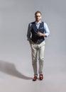 Walking suave stylish bearded man in classic vest Royalty Free Stock Photo