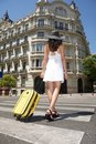Walking with suitcase on crosswalk Stock Photography